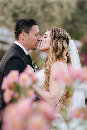FW-6736.JPG - Mirror\u0027s Edge Photography, a San Luis Obispo Wedding and Engagement Photographer, captures Rashel and Brian\u0027s Wedding Day at the Madonna Inn in San Luis Obispo. A secret kiss in the secret garden.
