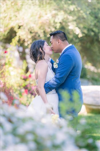 Maryanne and Michael at Madonna Inn 001 - Mirror\u0027s Edge Photography captures Maryanne and Michael\u0027s magical wedding in the Secret Garden at the iconic Madonna Inn in San Luis Obispo, California.  Bride and Groom kiss in the garden