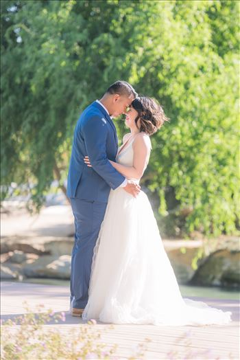 Maryanne and Michael at Madonna Inn 106 - Mirror\u0027s Edge Photography captures Maryanne and Michael\u0027s magical wedding in the Secret Garden at the iconic Madonna Inn in San Luis Obispo, California. Happy couple by the pond
