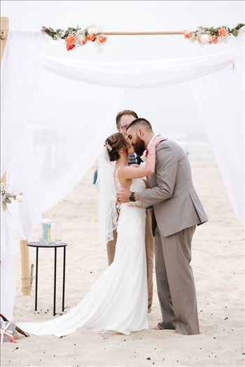 Sydney and Matthew 117 - Mirror\u0027s Edge Photography a San Luis Obispo Wedding Photographer captures Sydney and Matthew\u0027s Wedding on the Beach in Grover Beach, California. Beach Butlerz set up on the Beach Bride and Groom Kissing