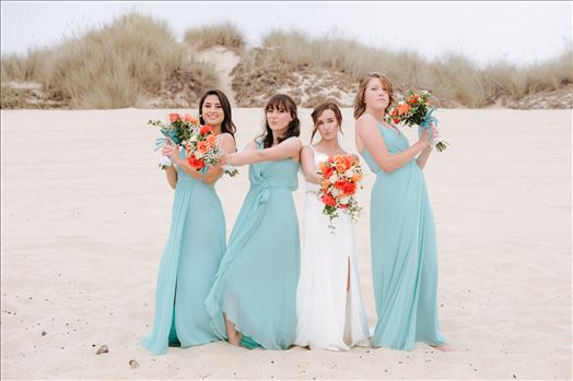 Sydney and Matthew 093 - Mirror\u0027s Edge Photography a San Luis Obispo Wedding Photographer captures Sydney and Matthew\u0027s Wedding on the Beach in Grover Beach, California. Bride and her bridesmaids on the beach having fun