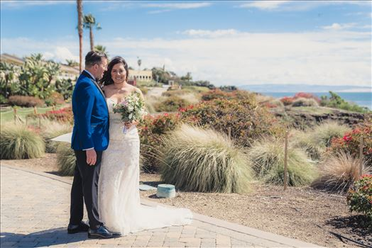 Candy and Christopher 22 - Wedding at Dolphin Bay Resort and Spa in Shell Beach, California by Sarah Williams of Mirror\u0027s Edge Photography, a San Luis Obispo County Wedding Photographer. Bride and Groom overlooking Pismo Beach