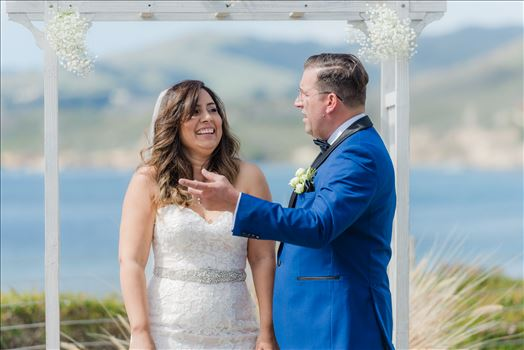 Candy and Christopher 13 - Wedding at Dolphin Bay Resort and Spa in Shell Beach, California by Sarah Williams of Mirror\u0027s Edge Photography, a San Luis Obispo County Wedding Photographer. Wedding vows at Spyglass