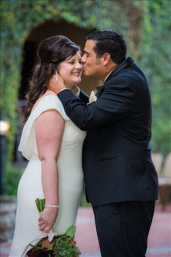 Mary and Alejandro 18 - Wedding photography at the Historic Santa Maria Inn in Santa Maria, California by Mirror\u0027s Edge Photography. Bride and Groom Hidden Courtyard kiss.
