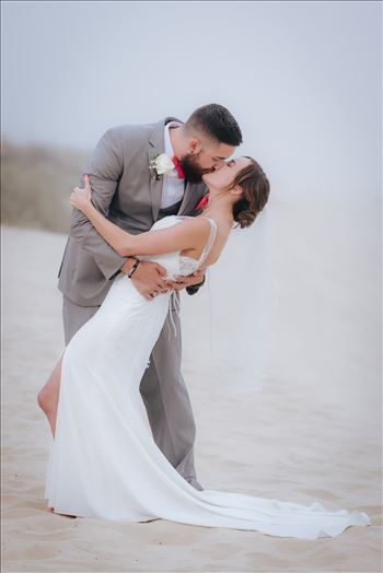 FW-8130.jpg - Romantic wedding in the sand on Grover Beach in California.  Barefoot with surfboards and driftwood, tent and ceremony set up by Beach Butlerz, wedding photography by Mirror\u0027s Edge Photography.  Romantic Bride and Groom dip in the fog