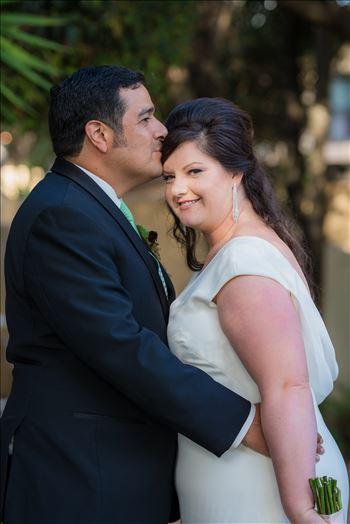 Mary and Alejandro 24 - Wedding photography at the Historic Santa Maria Inn in Santa Maria, California by Mirror\u0027s Edge Photography.  Bride and groom show love.