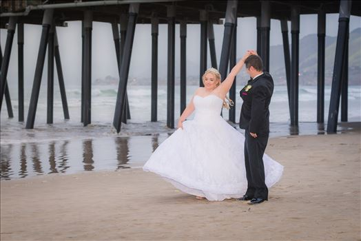 Jessica and Michael 68 - Sea Venture Resort and Spa Wedding Photography by Mirror\u0027s Edge Photography in Pismo Beach, California. Bride and Groom at Pismo Beach Pier