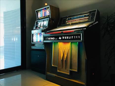 WURLITZER JUKEBOX AND DOUBLE BLACK TIE SLOT MACHINE.jpg by richardblank