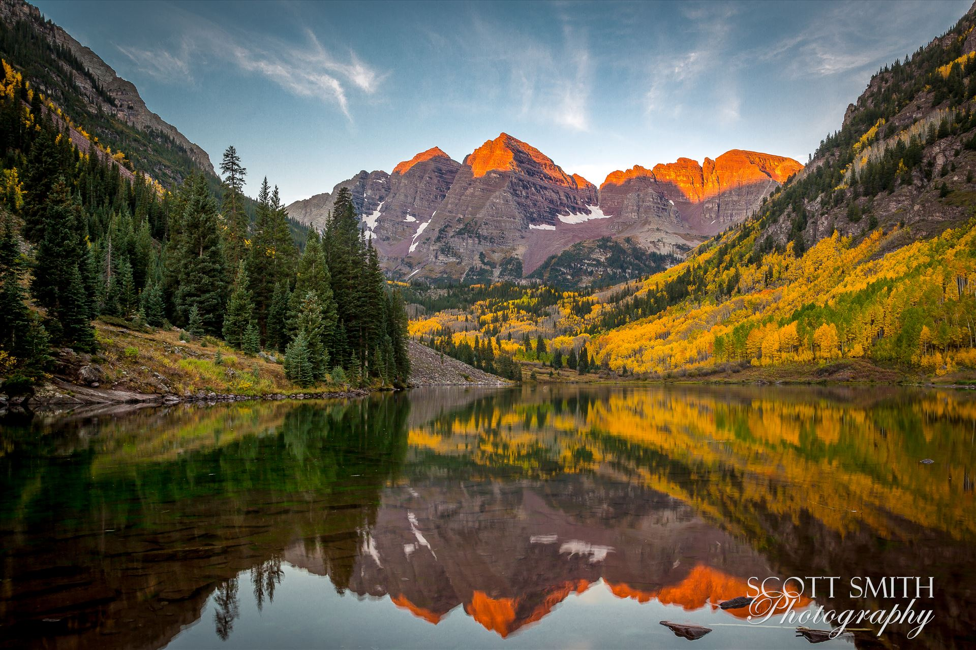 The sun rising on the Maroon Bells A chilly September morning.  The sun lights the peaks of the Maroon Bells. by Scott Smith Photos