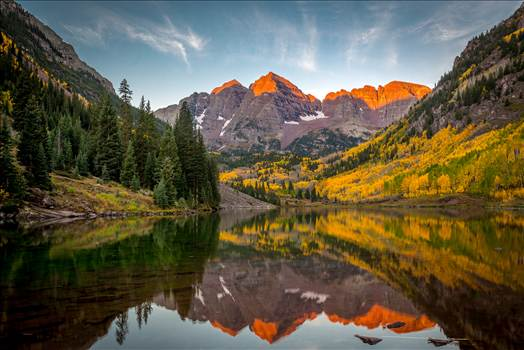 The sun rising on the Maroon Bells by Scott Smith Photos