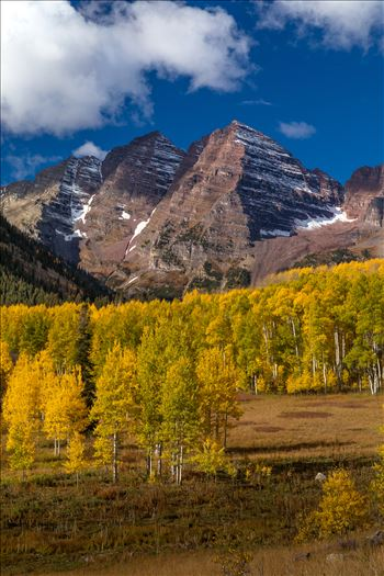 Maroon Bells from a Distance - The Maroon Bells a few miles from the lake framed by beautiful fall aspens.