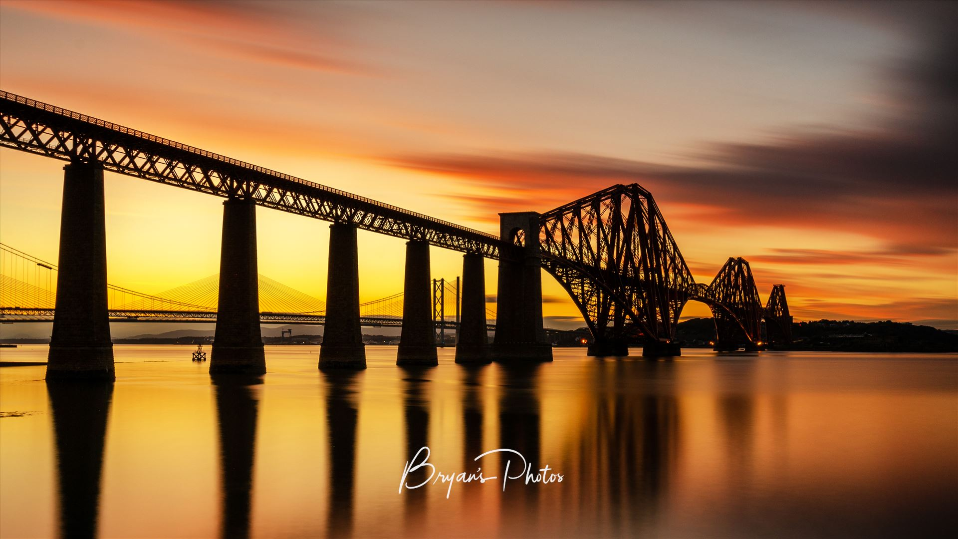 Rail Bridge Sunset Panorama A panoramic photograph of the Forth Rail Bridge taken at sunset from South Queensferry. by Bryans Photos