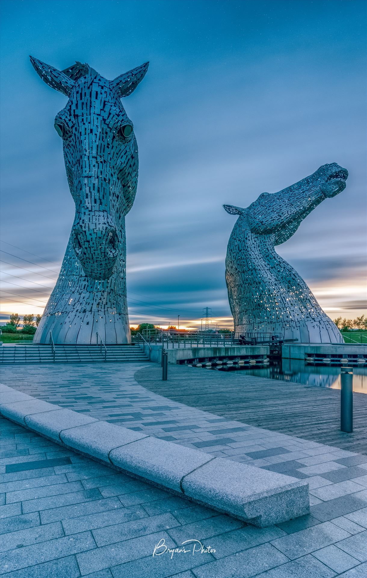 Evening at the Kelpies A long exposure photograph of the Kelpies taken just before sunset. by Bryans Photos