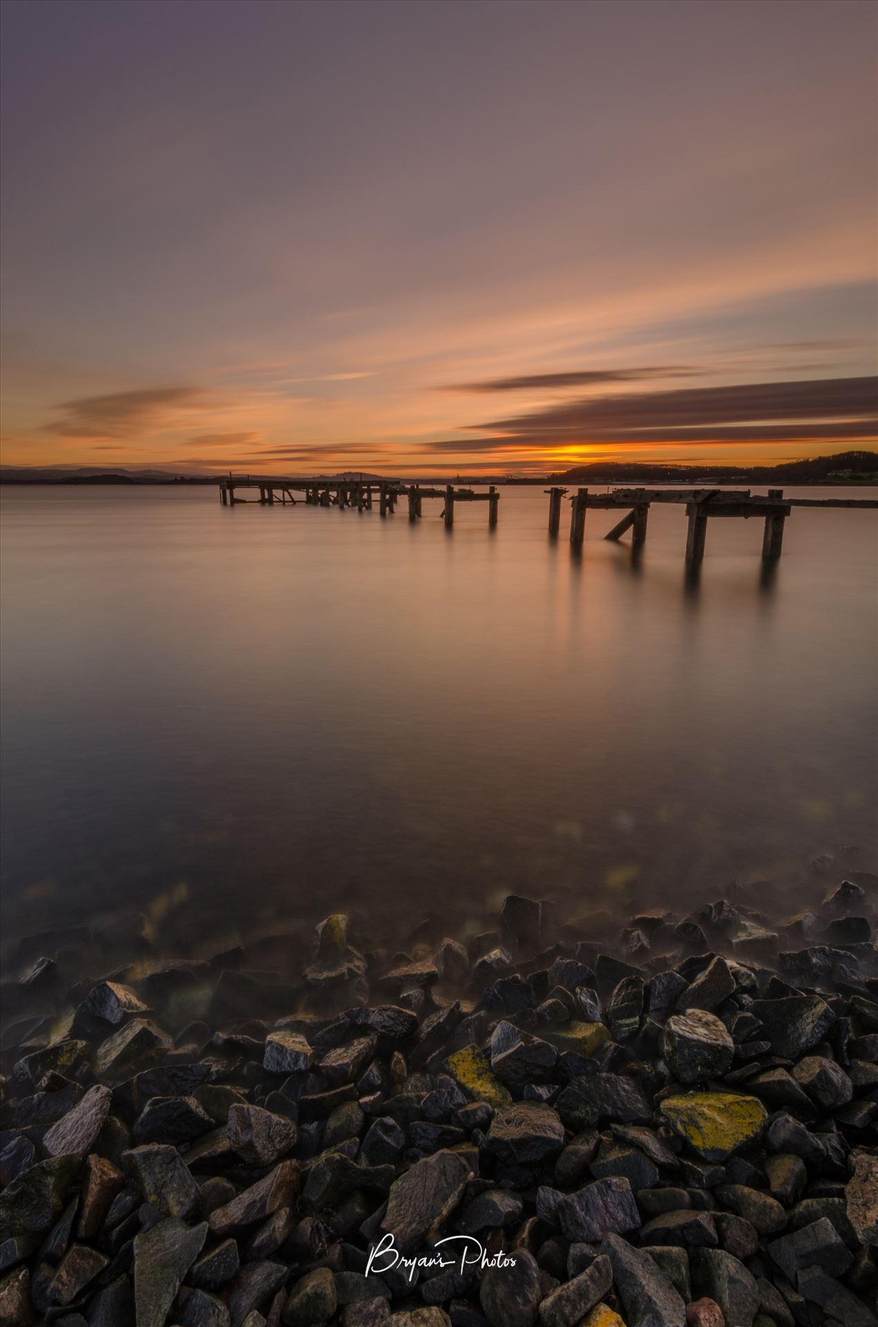 Aberdout at Sunset A photograph of the Abandoned pier at Aberdour on the Fife coast taken as the sun sets. by Bryans Photos