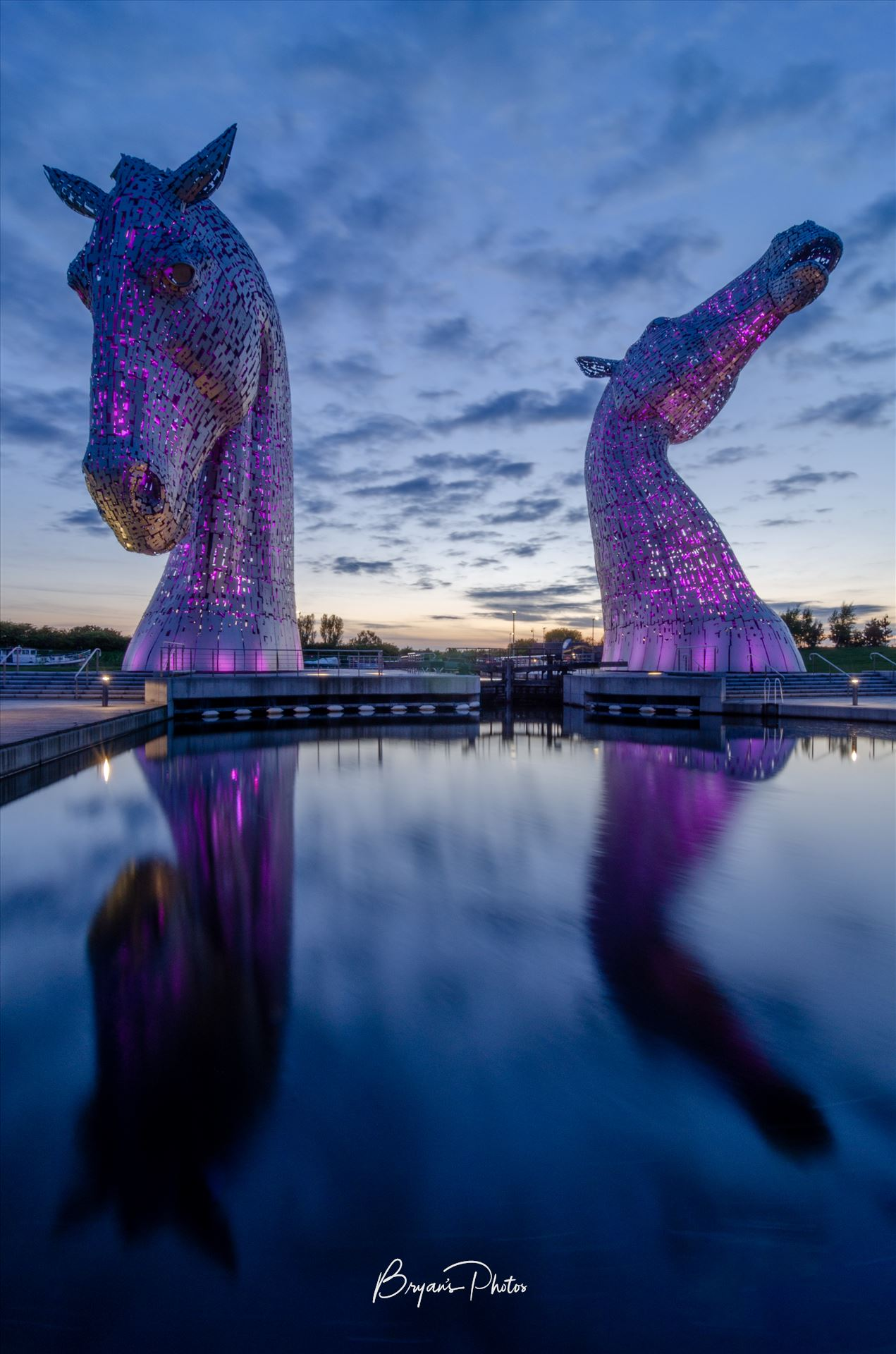Kelpies A photograph of the Kelpies lit up in purple taken just after sunset. by Bryans Photos