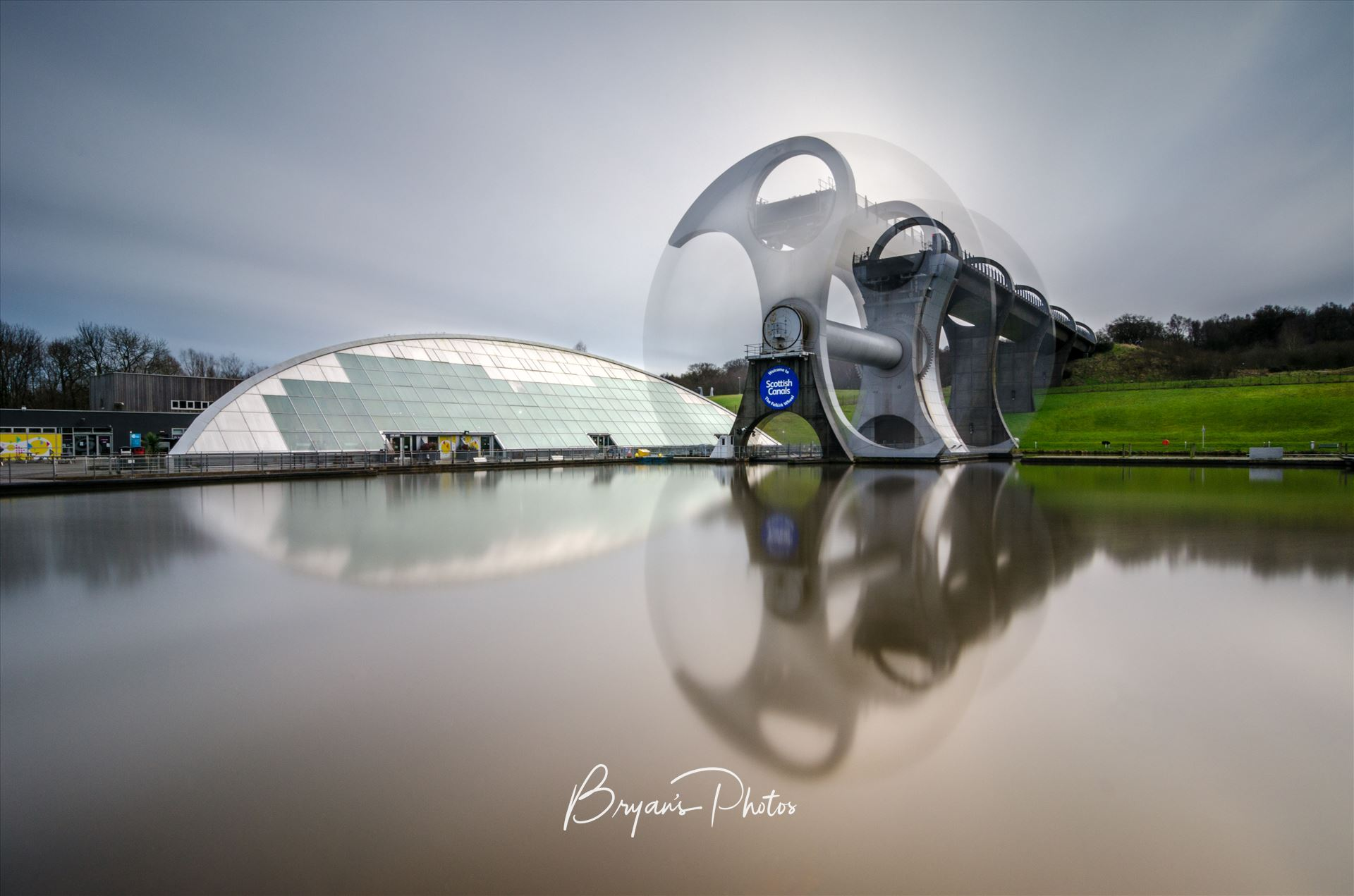 Falkirk Wheel In Motion A long exposure photograph of the Falkirk Wheel capturing the movement of the wheel as it lifts boats between the Forth and Clyde and Union canals. by Bryans Photos