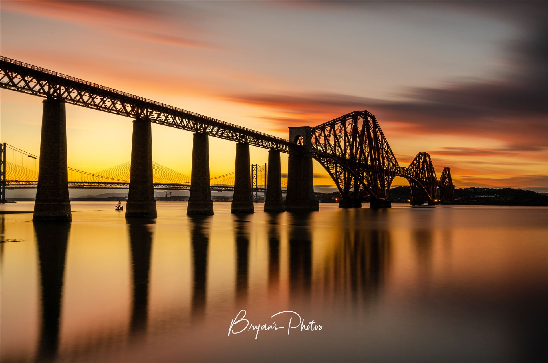 Rail Bridge Sunset A photograph of the Forth Rail Bridge taken at sunset from South Queensferry. by Bryans Photos