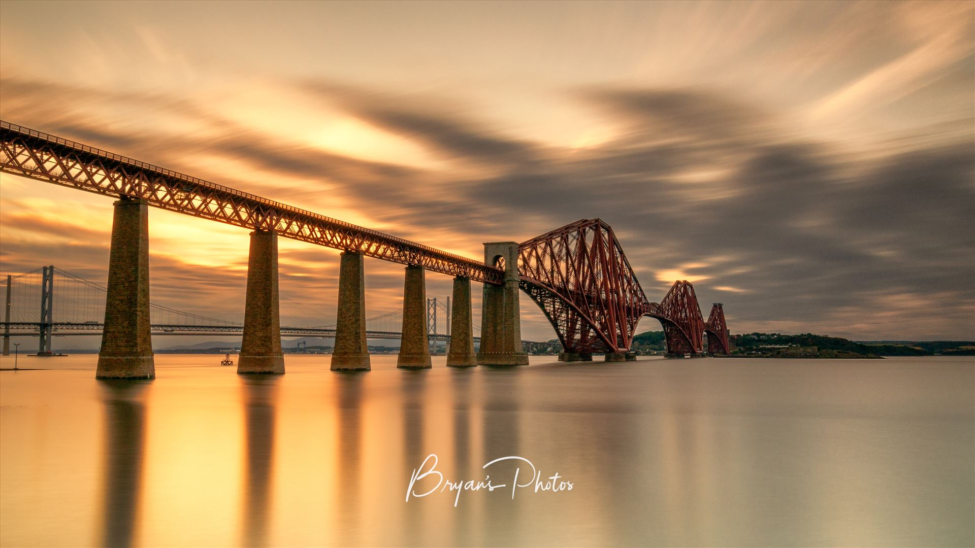Rail Bridge at Sunset A photograph of the Forth Rail Bridge taken at sunset from South Queensferry. by Bryans Photos