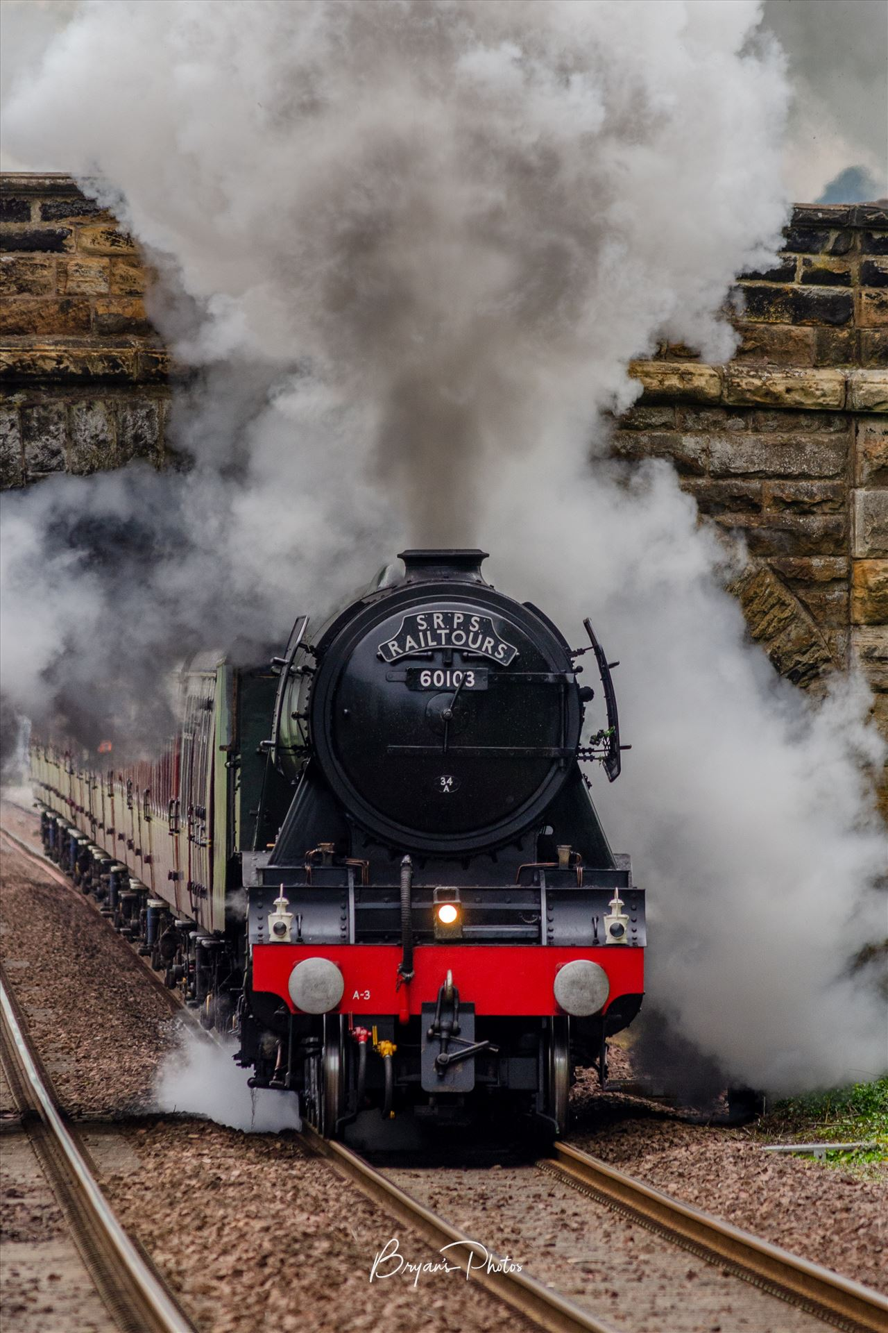60103 The Flying Scotsman A colour photograph of the Flying Scotsman under full steam approaching Dalgety Bay on the Fife circle. by Bryans Photos