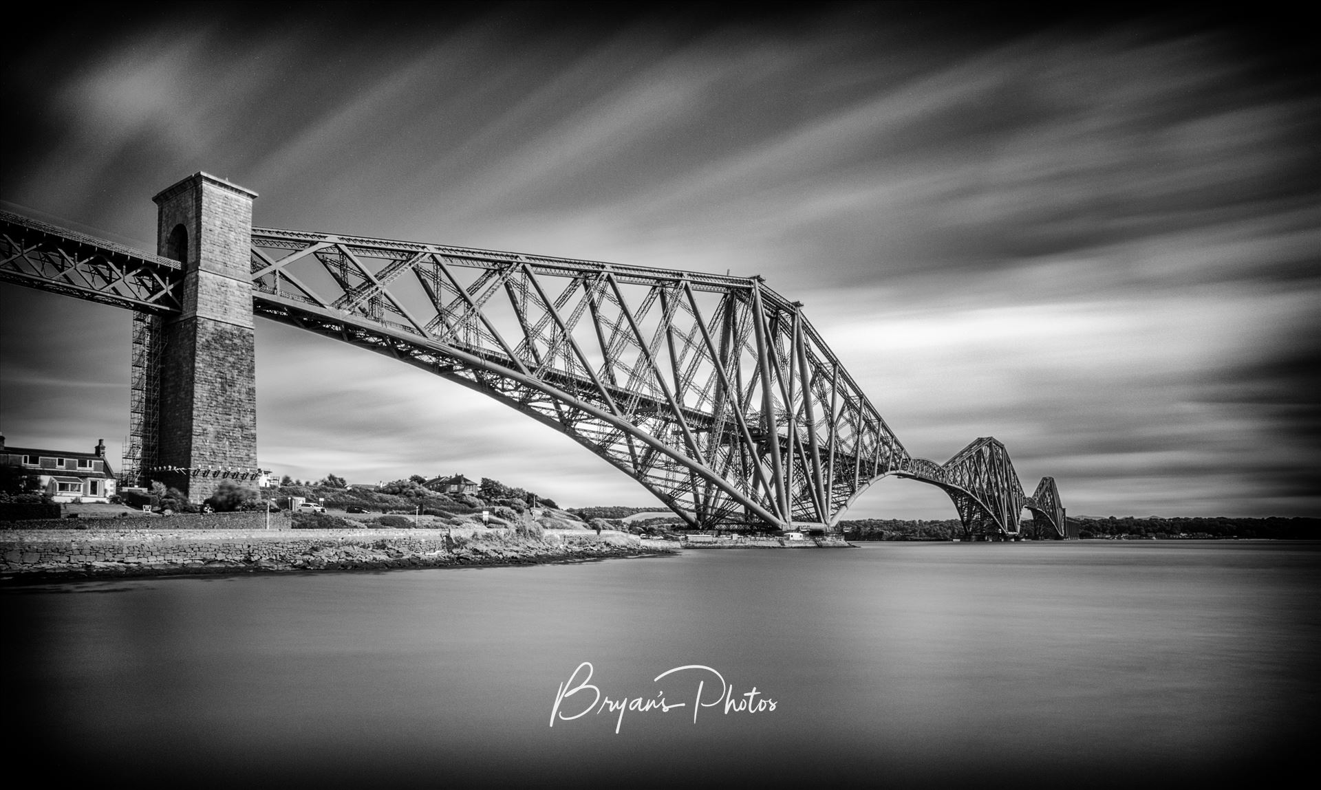 The Rail Bridge A black and white long exposure photograph of the iconic Forth Rail Bridge taken from North Queensferry. by Bryans Photos