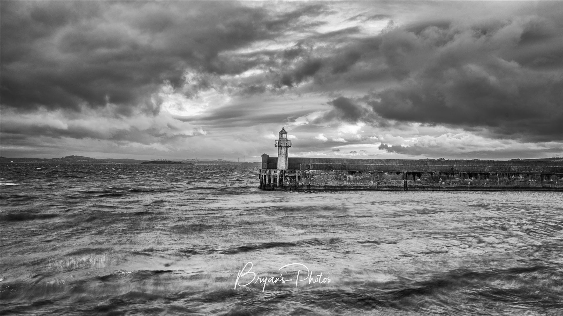 The Lighthouse A black and white photograph of the lighthouse at Burntisland Harbour on the Fife coast. by Bryans Photos