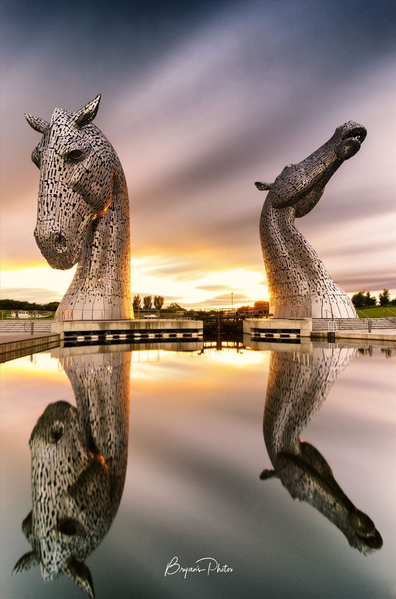 Kelpies Sunset A long exposure photograph of the Kelpies taken at sunset. by Bryans Photos