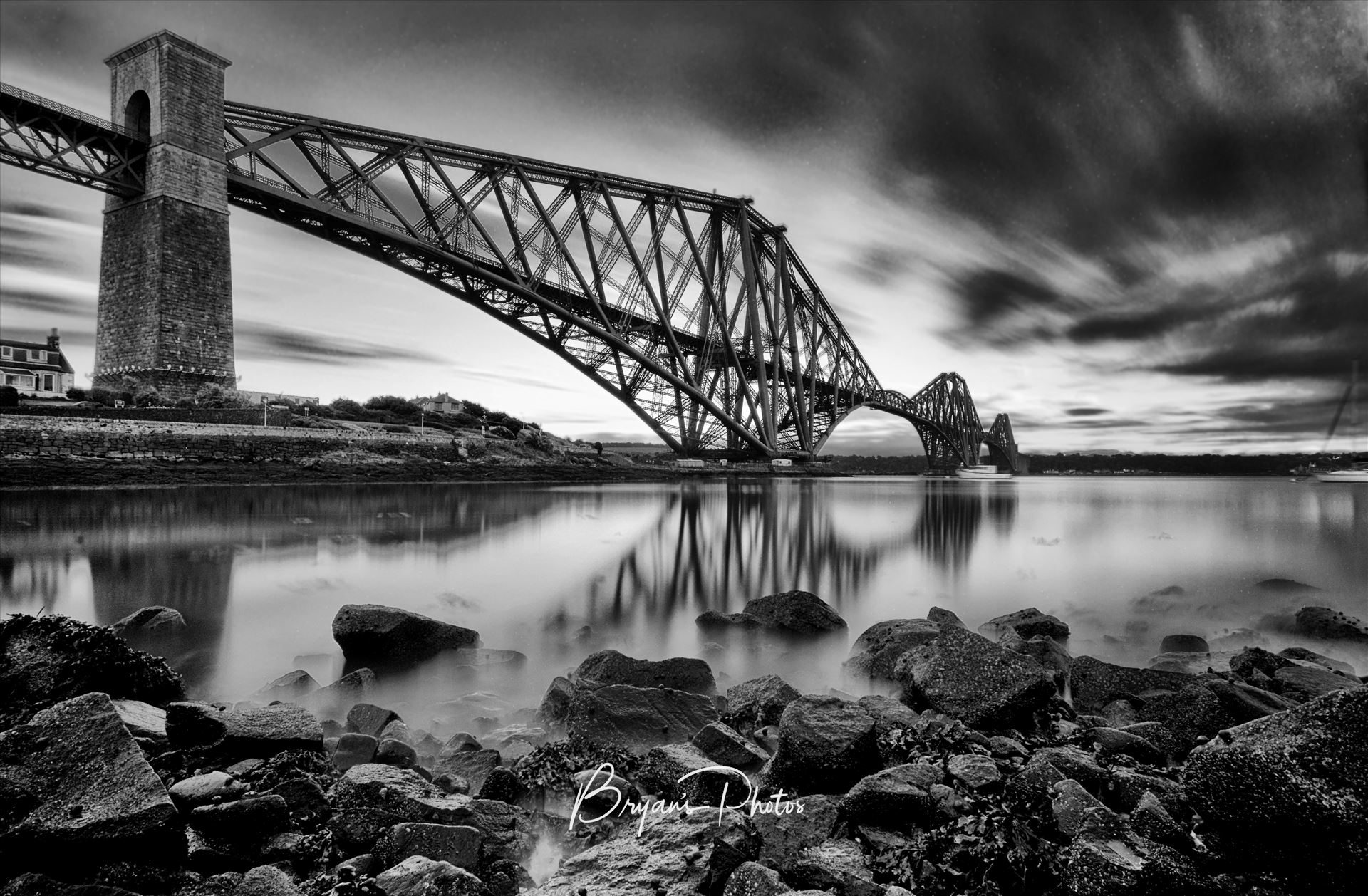 The Rail Bridge Black & White A black and white long exposure photograph of the iconic Forth Rail Bridge taken on a summer evening from North Queensferry on the banks of the river Forth. by Bryans Photos