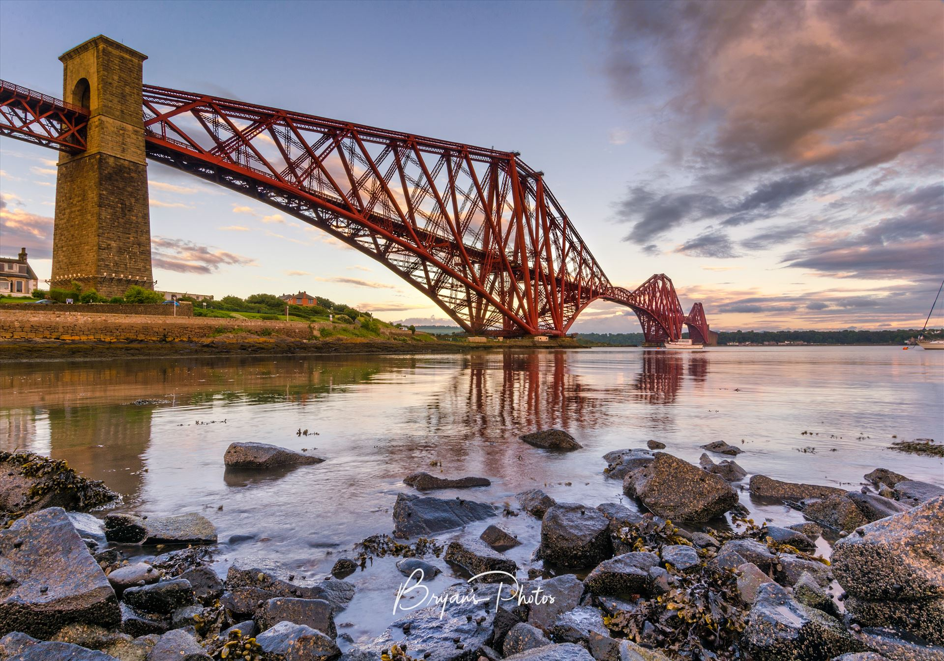 The Bridge A colour photograph of the Forth Rail Bridge taken from North Queensferry at sunet. by Bryans Photos