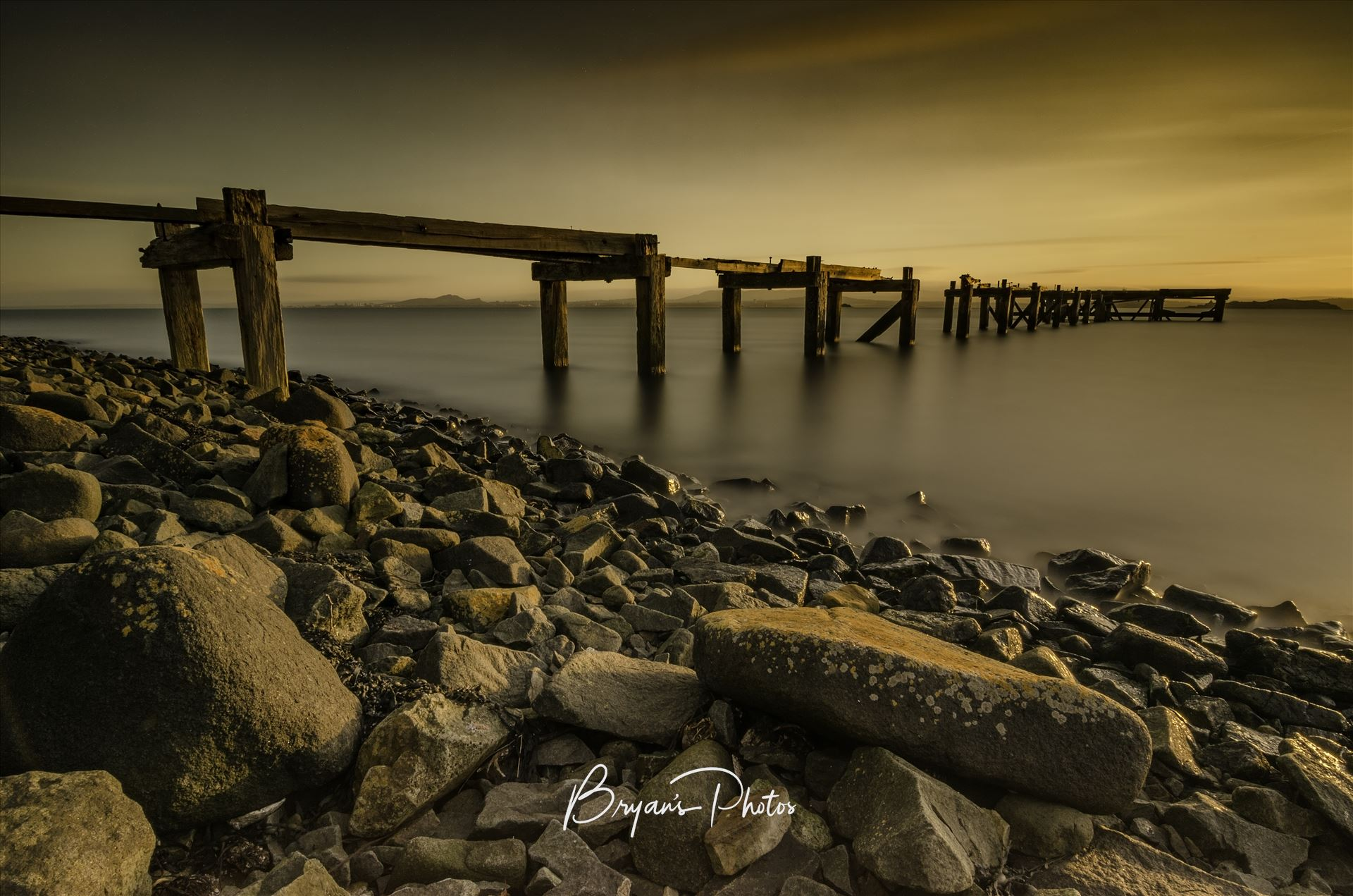 Hawkcraig Pier A long exposure photograph of the abandoned  Hawkcraig pier at Aberdour taken at sunset. by Bryans Photos