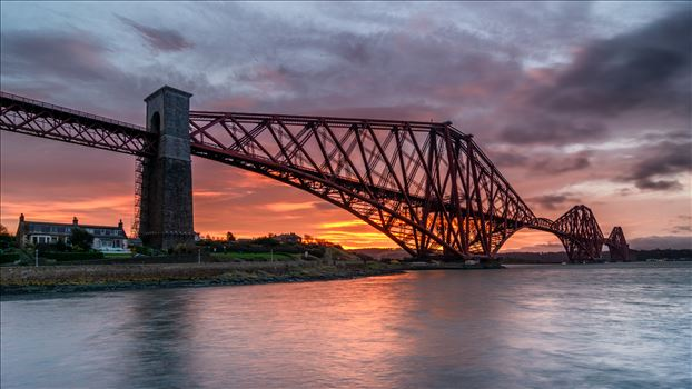 North Queensferry Sunrise - A photograph of the Forth Rail Bridge taken at Sunrise from North Queensferry.