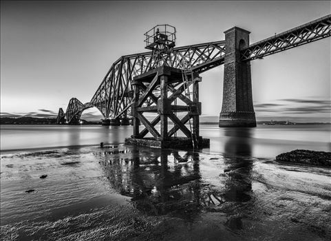 Hawes Pier - A black and white photograph of the Forth Rail Bridge taken from the End of Hawes Pier at low tide.
