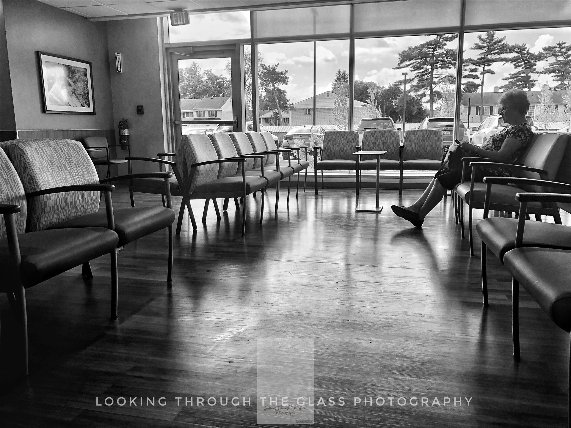 By Her Lonesome Silhouette of a woman down in black and white in a hospital waiting room.  by Janey