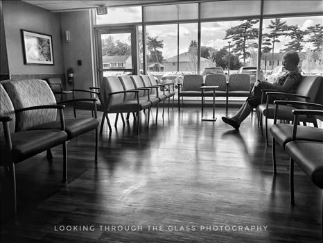 By Her Lonesome - Silhouette of a woman down in black and white in a hospital waiting room.