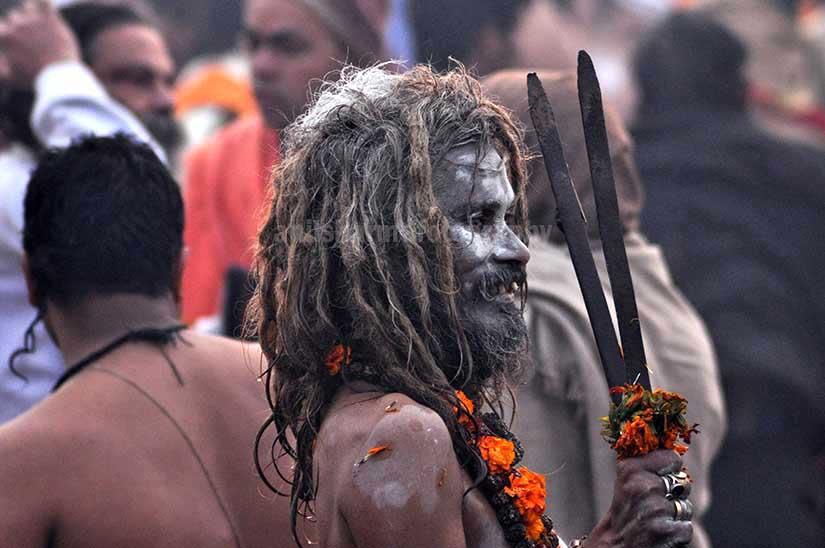 Culture- Aghori Sadhu's (India) Smile of an old Aghori baba with long hairs, ash on face at Mahakumbh Prayag, Allahabad, Uttar Pradesh (India). by Anil Sharma Photography