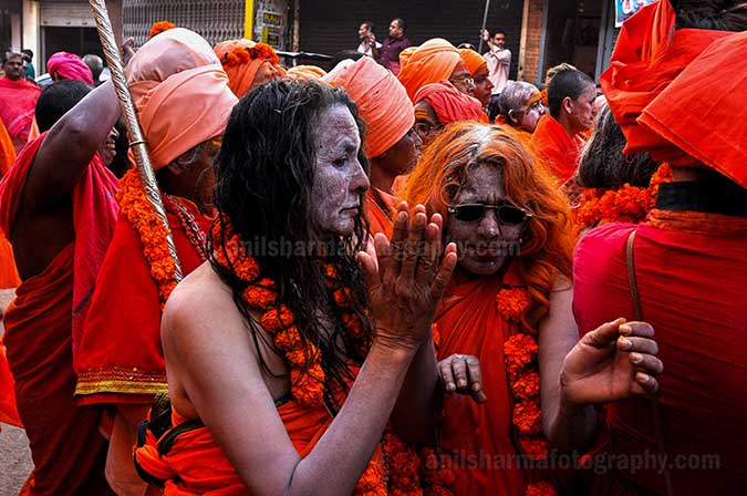 Culture- Naga Sadhu's (India) Women Naga Sadhu's procession passing through the streets of Varanasi. by Anil Sharma Photography