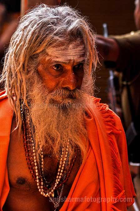 Culture- Naga Sadhu's (India) Close-up of an old Naga Sadhu wearing beads mala at Varanasi. by Anil Sharma Photography