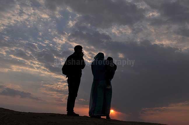 Festivals: Jaisalmer Desert Festival Rajasthan (India) A family enjoying sunset scene at Jaisalmer. by Anil Sharma Photography