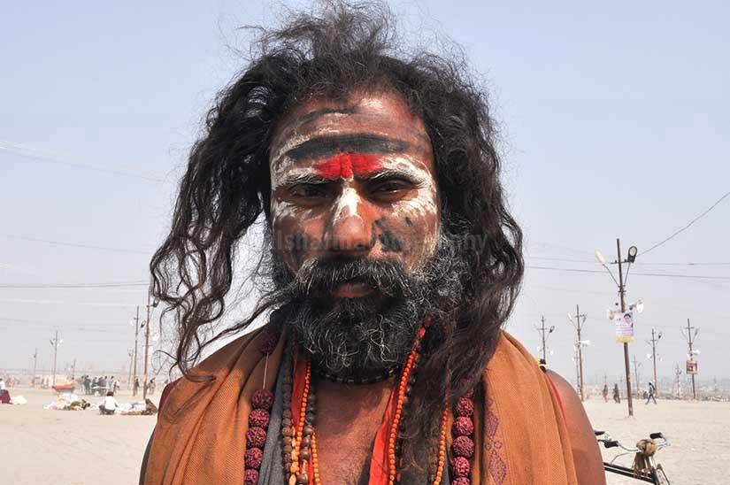 Culture- Aghori Sadhu's (India) Aghori Sadhu with long hairs, ash and tilak on face wearing rudraksha bead at Mahakumbh mela, Allahabad, Uttar Pradesh, India. by Anil Sharma Photography