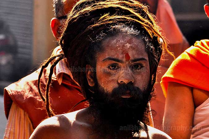 Culture- Naga Sadhu's (India) A Naga Sadhu with Holy Tikal on forehead passing through a small lane of Varanasi. by Anil Sharma Photography