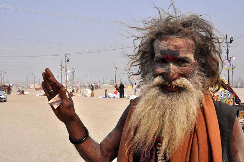 Culture- Aghori Sadhu's (India) Smile of an old Aghori Sadhu with long hairs, ash on face at Mahakumbh Prayag, Allahabad, Uttar Pradesh (India). by Anil Sharma Photography