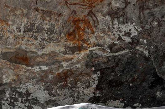 Archaeology- Bhimbetka Rock Shelters - Prehistoric Rock Painting- a Hunter aiming at a deer at Bhimbetka archaeological site