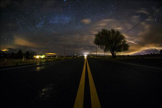 Milky Way Peeking From Behind The Clouds.jpg by Joey Onyxone Sandoval